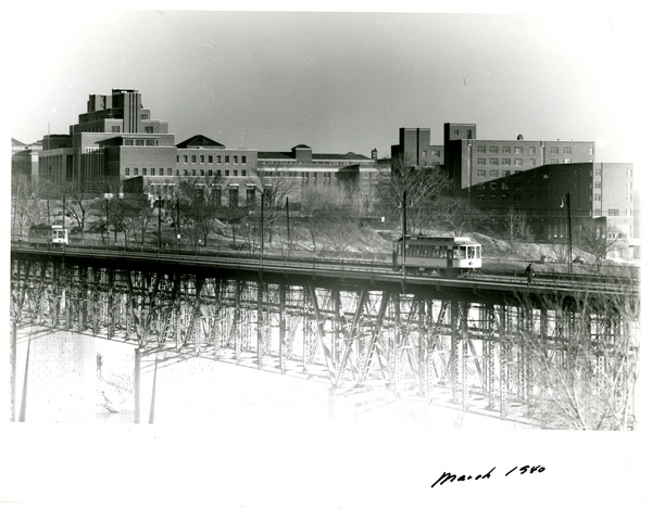 Coffman Union. Mpls. Campus. View from Wash. Ave. Bridge w_ Trolley Cars.