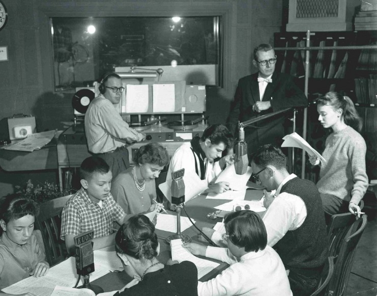 KUOM engineers and radio performers in the studio in 1959. New studios were constructed for broadcasting in the basement of Eddy Hall and station operations moved to Eddy in the spring of 1939. The station operated out of Eddy from 1939 to 1974, when it moved to new facilities in the Rarig Center, the present operating location of Radio K.