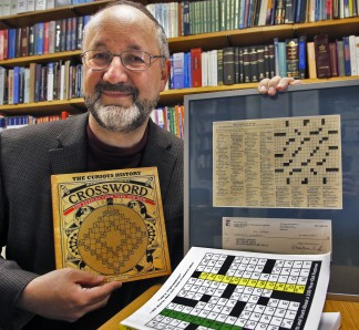 U of M chemistry professor George Barany is a cross word puzzle fan, creating many new puzzles and winning puzzle contests. Here he displays a book showing the first cross word puzzle created in 1913, as well as a display of his first NYT puzzle including the dollar he kept from the prize money. MARLIN LEVISON/STARTRIBUNE (mlevison@startribune.com)