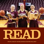 Three Gopher Women's basketball players holding books and basketballs at center court at Williams Arena.