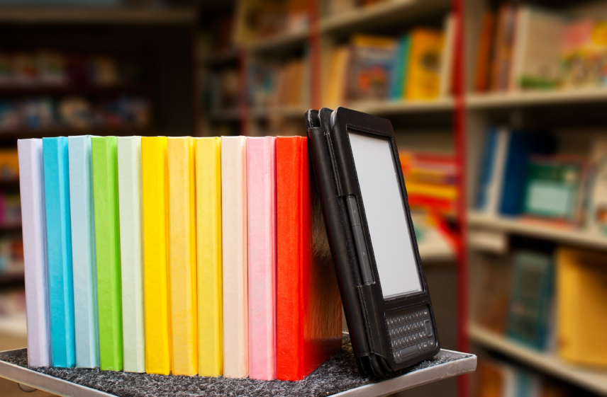 Row of colorful books with electronic book reader