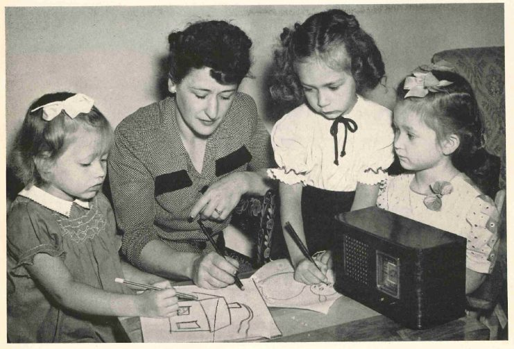 """Woman and children create illustrations as they listen to """"Drawing to Music"""" over KUOM, 1946."""