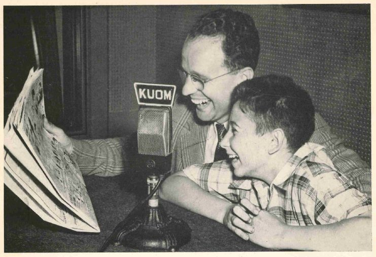 Announcer George Grim with a boy reading the daily comics over the air, 1946.