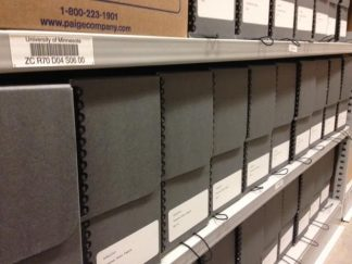 Picture of hollinger boxes on shelves showing the processed Heino Taremäe Papers.