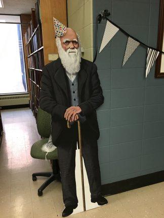 Cutout of Charles Darwin celebrating his birthday