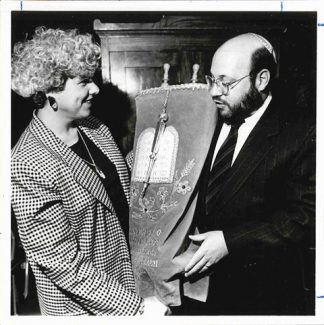 Stacy Offner with Morris Allen, receiving a Torah scroll, undated