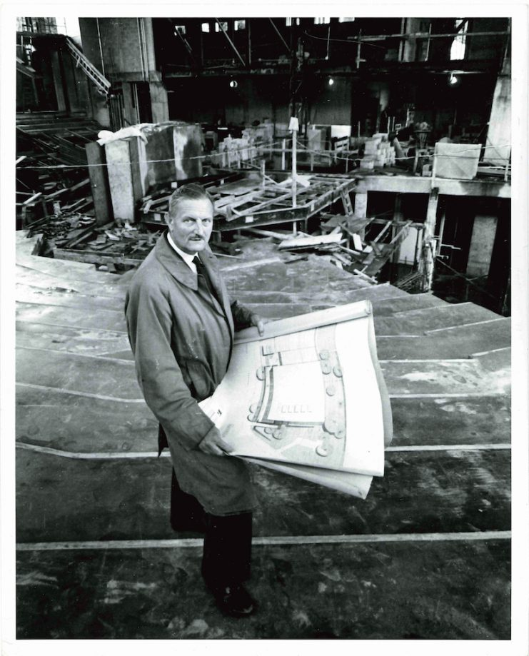 Tyrone Guthrie stands in the Guthrie Theater auditorium while it is mid-construction. Photographer unidentified. Image courtesy of the Guthrie Theater Records, Performing Arts Archives, University of Minnesota Libraries.