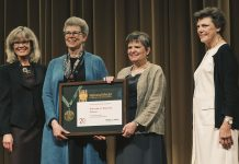 Wendy Lougee and Jennifer Gunn accept the National Medal for Museum and Library Service. At far left is Dr. Kathryn K. Matthew, director of the Institute of Museum and Library Services. At far right is Cokie Roberts, Journalist and Commentator for National Public Radio and ABC News.