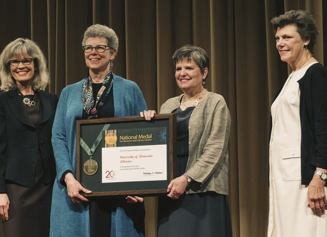 Jennifer Gunn and Wendy Lougee accept the National Medal for Museum and Library Service