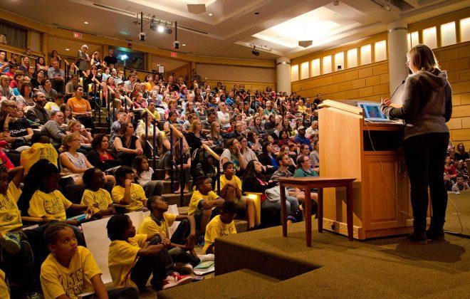 Raina Telgemeier speaking to a capacity crowd in Cowles Auditorium