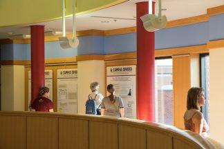 Exhibit visitors looking at the exhibit panels in Andersen Library.