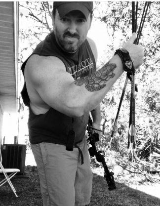 Jason Herbert with his turtle tattoo.
