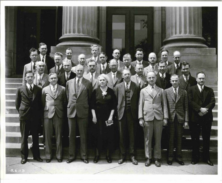 Photograph of the University of Minnesota Department of Chemistry faculty in 1936. Lillian Cohen is pictured front row center.
