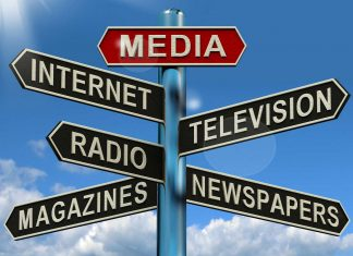 Sign post featuring various media formats, for example Magazines, Newspapers, Television, Internet.