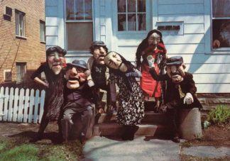 Photograph of the cast of a Befana performance by the Heart of the Beast Puppet Theatre, from the Immigration History Research Center Archives' Vannelli Papers.
