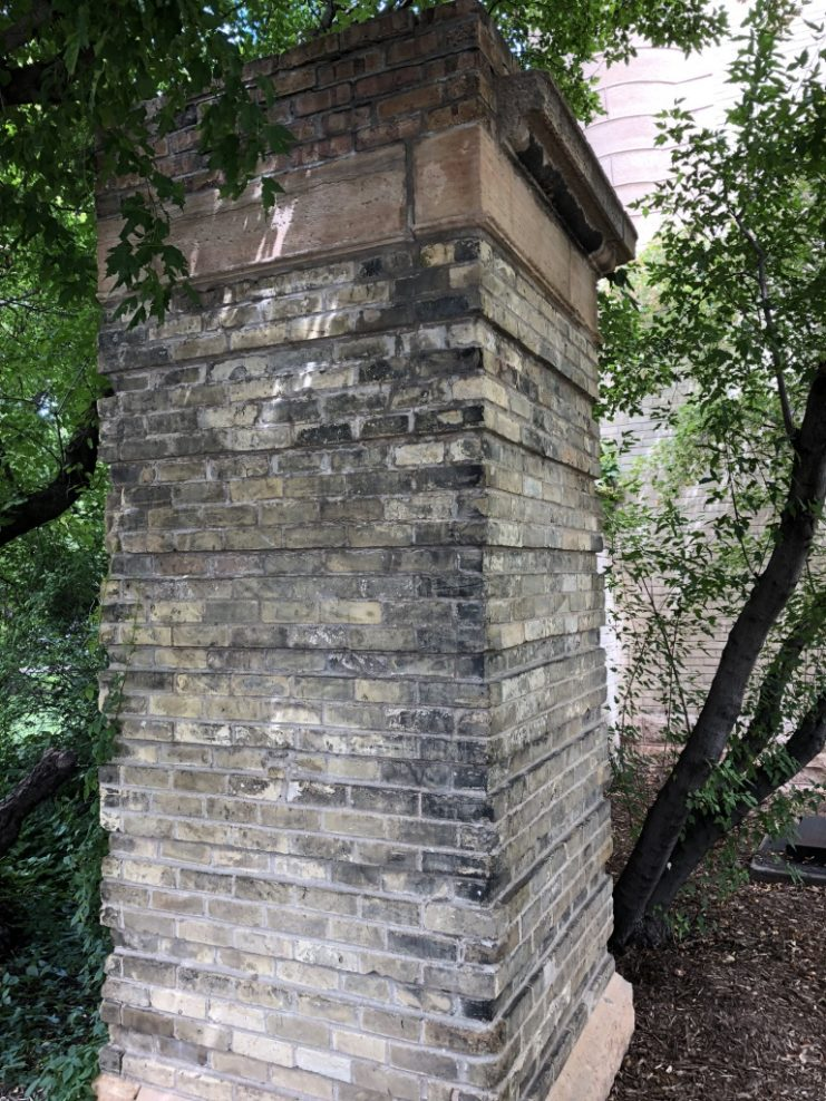 A remnant of a Northrop Field pillar at the southwest corner of the Armory.