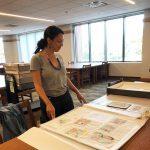 K-Fai Steele looking at James Marshall's materials at Andersen Library