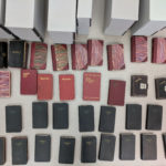 Overhead view of all 44 of Tometaro Kitagawa's diaries spread across a table before being processed.