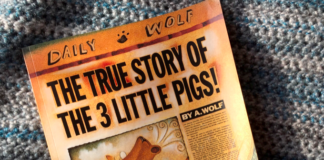 Faux Newspaper front page with a profile of a wolf's head blowing three pig's butt ends out of the photo frame on sepia toned aged paper