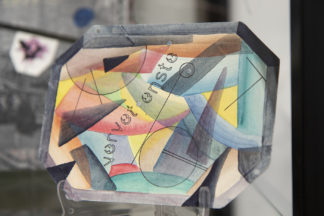 Mail art from the Stamped and Posted exhibit features watercolor art on paper with abstract, geometric shapes.