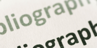 """Photo of """"bibliography"""" typed repeatedly on paper."""