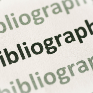"Photo of ""bibliography"" typed repeatedly on paper."
