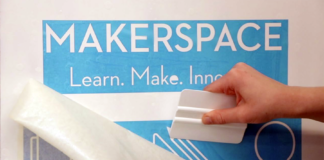 Photo of person using a stencil made at the Makerspace