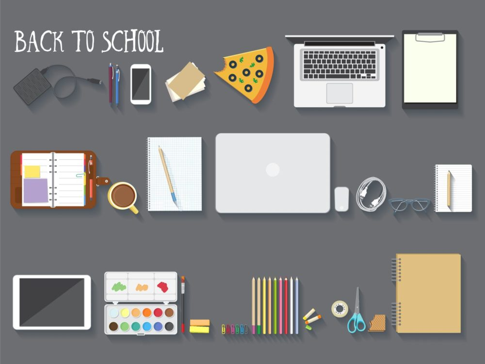 School supplies arranged neatly in rows, plus a piece of pizza with a bite taken out.