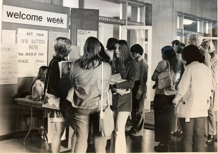 Photograph: Students attending Welcome Week in 1971 at an informational table.