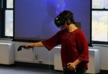Teresa Bisson demonstrating virtual reality