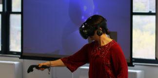 Teresa Bisson demonstrating virtual reality