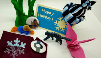 Examples of things you can make in the makerspaces: 3D printed figures, cards, buttons, embroidered cloth, origami cranes, yarn hats.