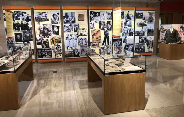 Snapshot of exhibit gallery with banners and exhibit cases