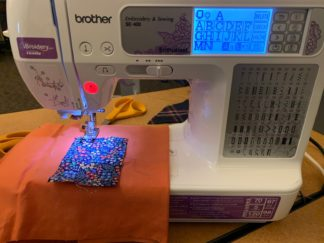 Digital embroidery machine in action.
