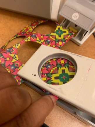 Button being made