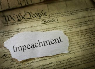 The word Impeachment superimposed over the Constitution.