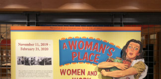 """Banner for """"Women and Work"""" exhibit, with woman in an apron holding canned foods"""