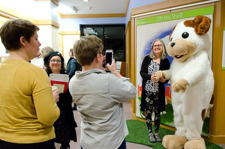 Guests took photos with the poky little puppy at the exhibit opening celebration for The ABC of It: Why Children's Books Matter.