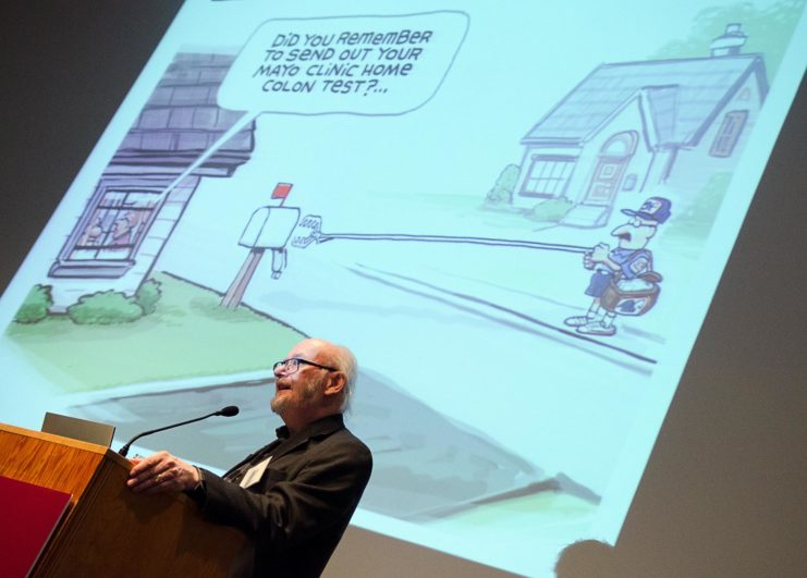 """The Friends of the Libraries gathered at the Weisman Art Museum on a Sunday afternoon in February to enjoy delicious food and an entertaining talk by editorial cartoonist Steve Sack. Sack, who won the PulitzerPrize for Editorial Cartooning in 2013, shared cartoons from his career at the Star Tribune during his talk,""""I read the paper, I crack a joke, and I draw a picture.""""Guests enjoyed appetizers and ambience at the Weisman Art Museum."""
