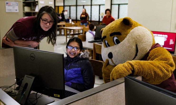 Alicia Kubas, Government Publications Librarian, and Goldy helping out a student at Gopherbaloo