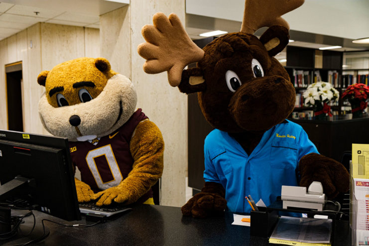Goldy and Mooster take their shift at the Wilson Library Service Desk