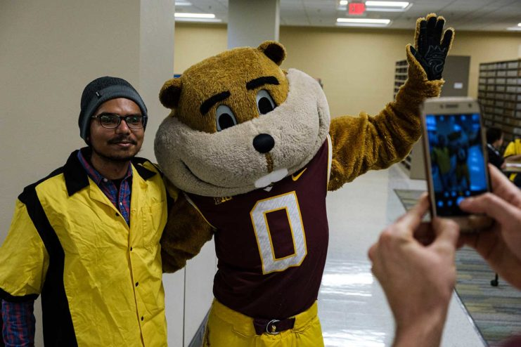 A Gopherbaloo staff member getting his photo taken with Goldy