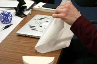 Vinyl sticker being applied to laptop