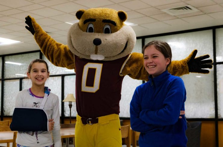 Two Gopherbaloo students posing with Goldy