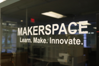 Window of the Makerspace which says Learn. Make. Innovate.