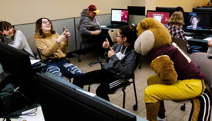 Students at Gopherballoo taking photos with Goldy