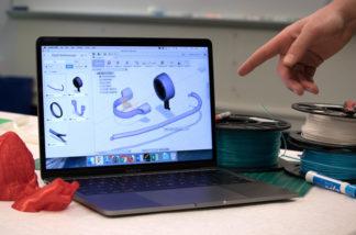 Computer monitor displaying 3D design software