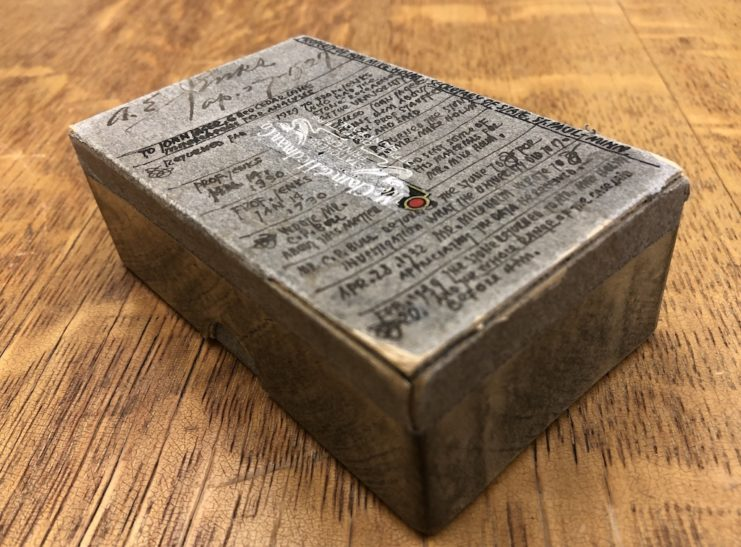 Cardboard box that was used to transport the stone. Handwritten notes on the top of the box detail who had the stone between 1927 and 1939.