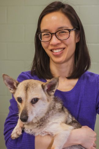 Rosalind Chow holding her dog