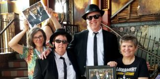 Claire Stewart, Betsy Friesen, Shane Nackerud, and Wendy Lougee with Betsy and Shane dressed as the Blues Brothers